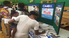 CAAB Engages with Ward 8 Families Attending Back to School Night at Charles Hart Middle School to Raise Awareness of the EITC
