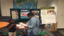 Raising EITC Awareness in Ward 8 at Bishop John T. Walker School for Boys' Back to School Night